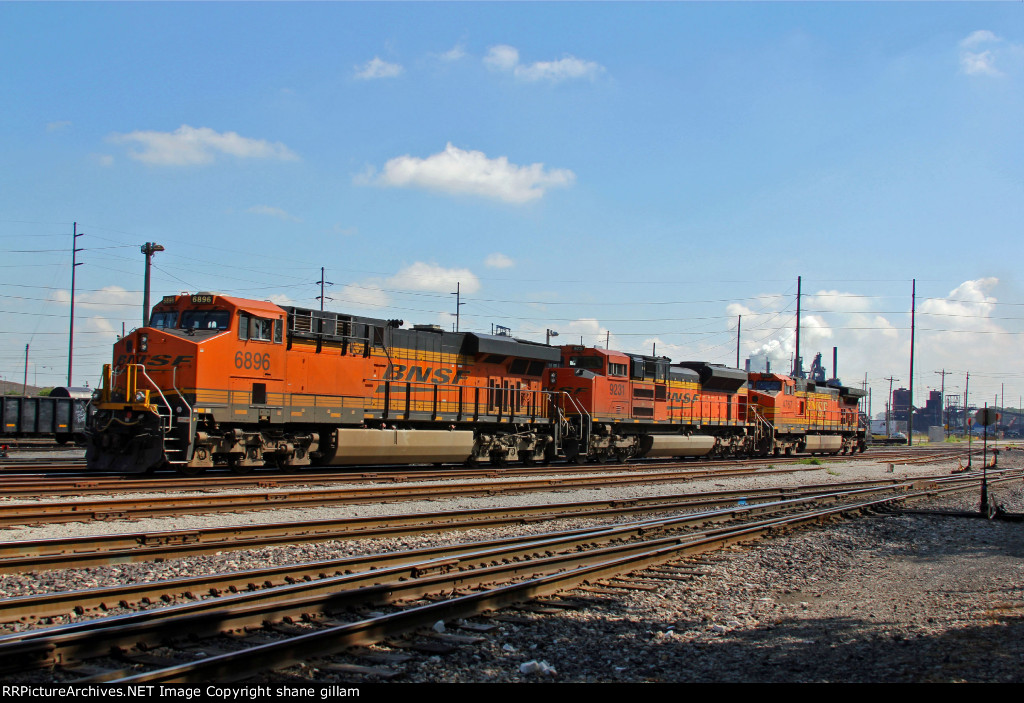 BNSF 6896 sits and waits for the ore train to be unloaded.