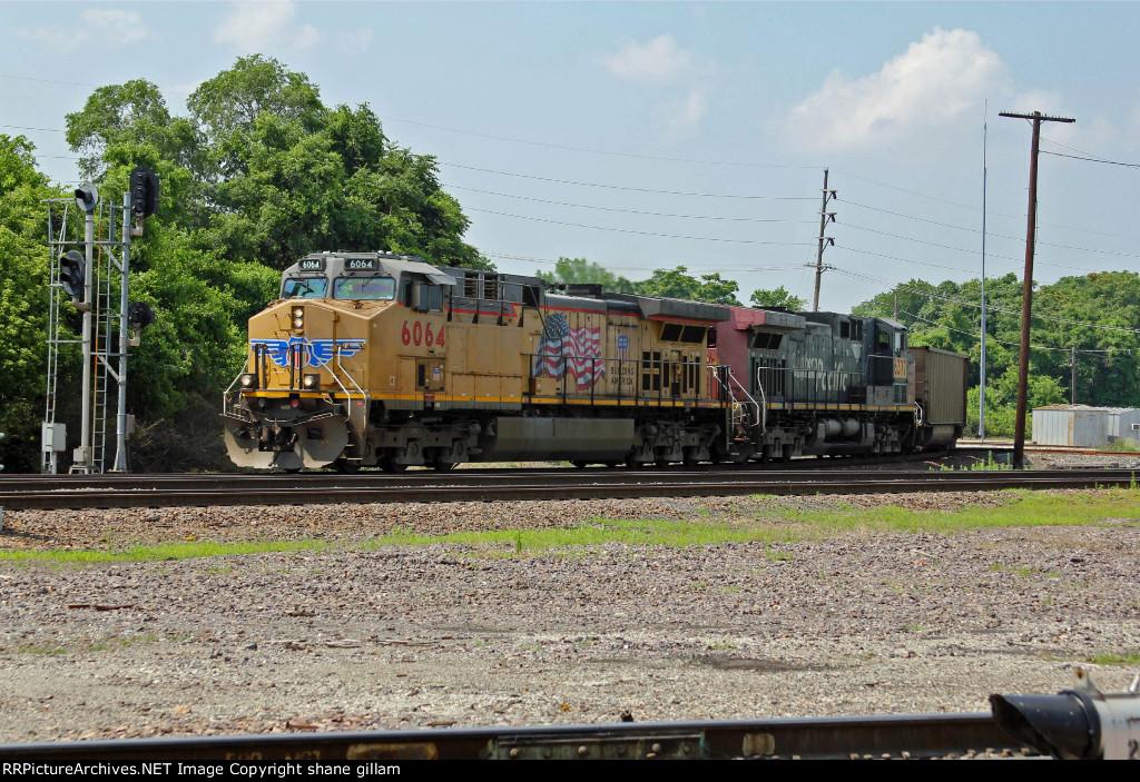 UP 6064 Heads up a SB coal train.