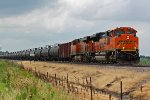 BNSF 9149 Leads a oil train Nb out of the siding.
