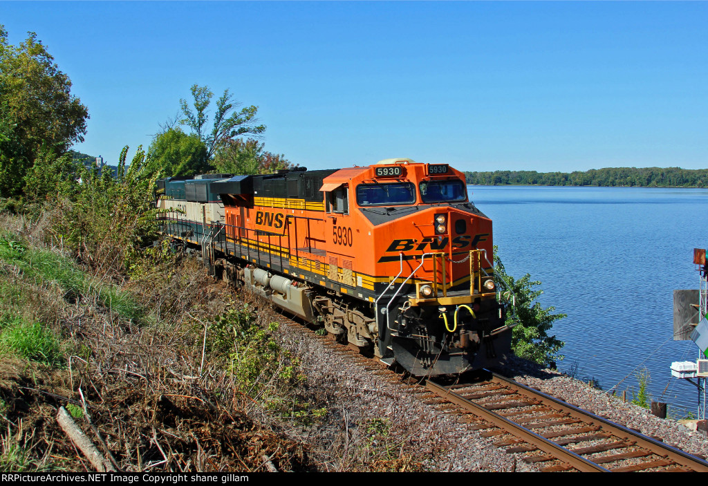 BNSF 5930 Leads a loaded coal next to the Mississippi river.