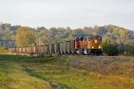 BNSF 8897 Strolls along with a coal load.