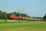 BNSF 5940 rolls a coal load SB down the k line.