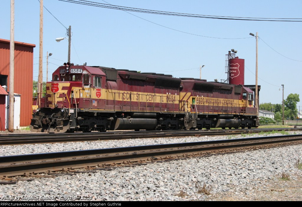 WC 6584 with WC 6620 at the Stevens Point roundhouse.