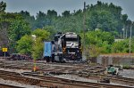 NS 5824 and a former Conrail caboose are off duty in the yard.