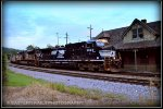 NS 9-40CW 9923 leads 819 past the ex N&W station