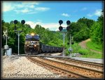 NS 9911 leads an eastbound coal drag