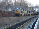 Q438 heads north with CSX, IC and CN power trailing