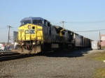Q433 rolls past the station downgrade heading for Oak Island yard(eventually)