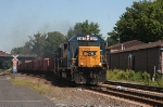 Southbound stone train with a GP40-2/Road Slug for power crosses from tracl 1 to 2 at CP 5