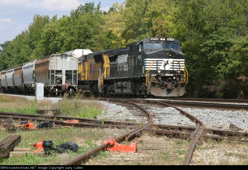NS203 passes NS118 if front of the Southeastern Railway Museum