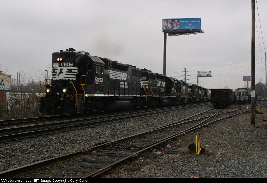 NS Train #119 has plenty of power with a mixed consist passing Armour Yard