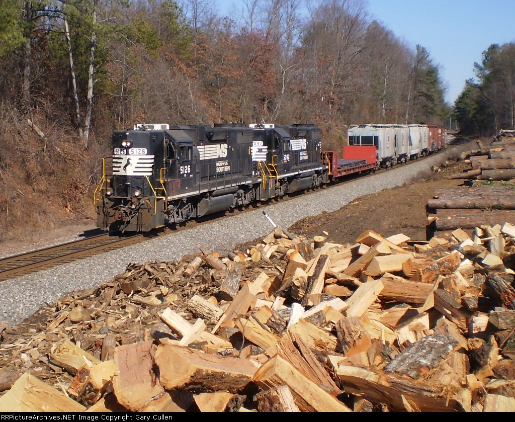 NS P68 rarely makes it above Duluth.  Here it is seen passing the wood yard south at Suwanee