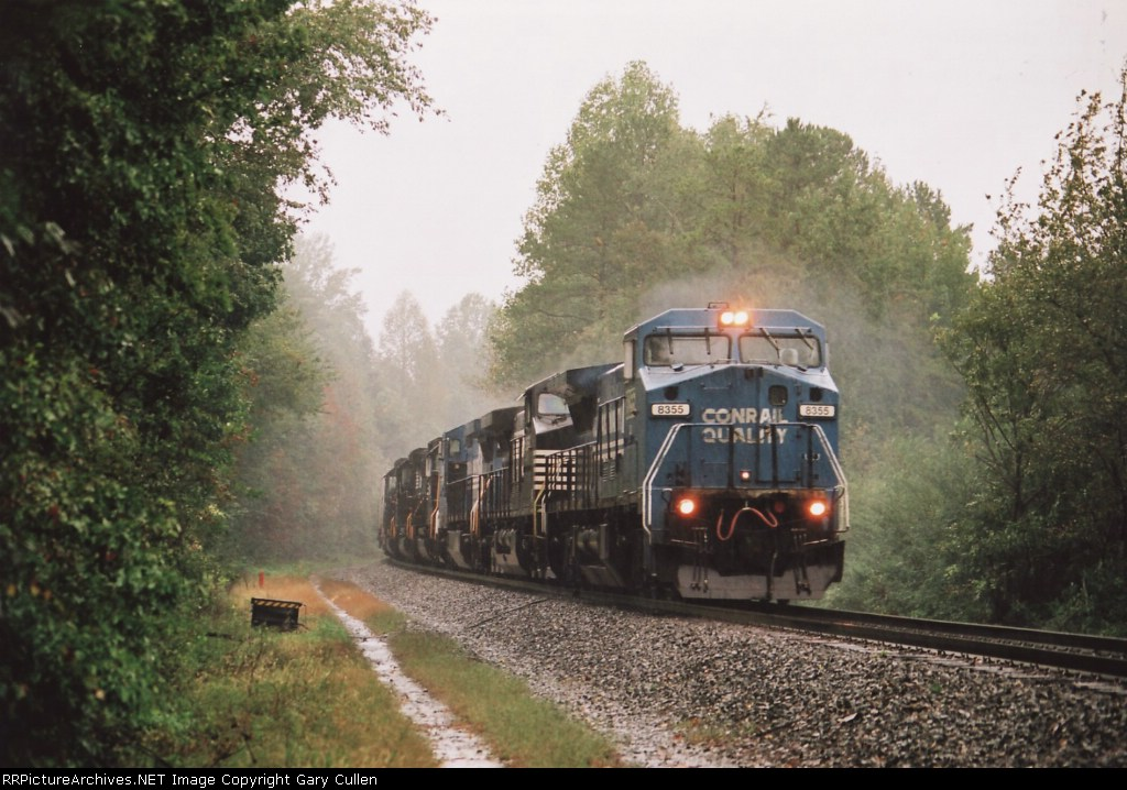 NS Train #153 moves past the greaser during a tremendous downpour
