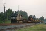 NS Dash 9 with a very long set of cats behind the wrecked trucks & body of the 5531