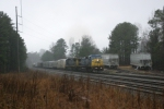 CSX Northbound passes a hopper that is being unloaded