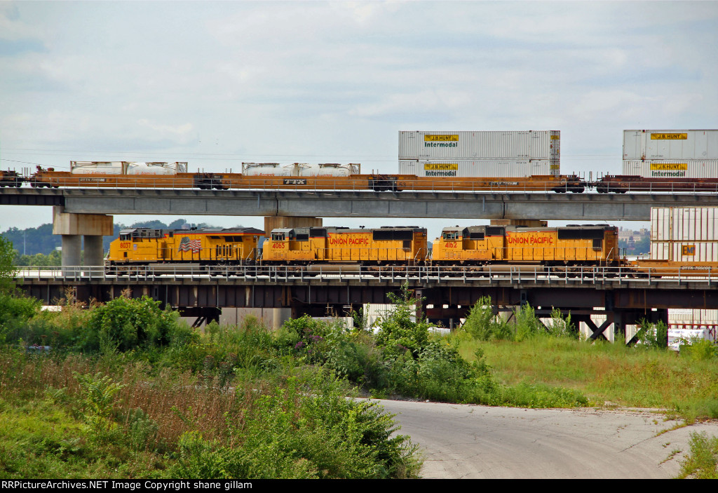 UP 8037 Heads up a Wb stack while a BNSF stacks heads over top.