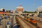 WB BNSF heading Past Kc Union Station and the Known Western Auto sign.