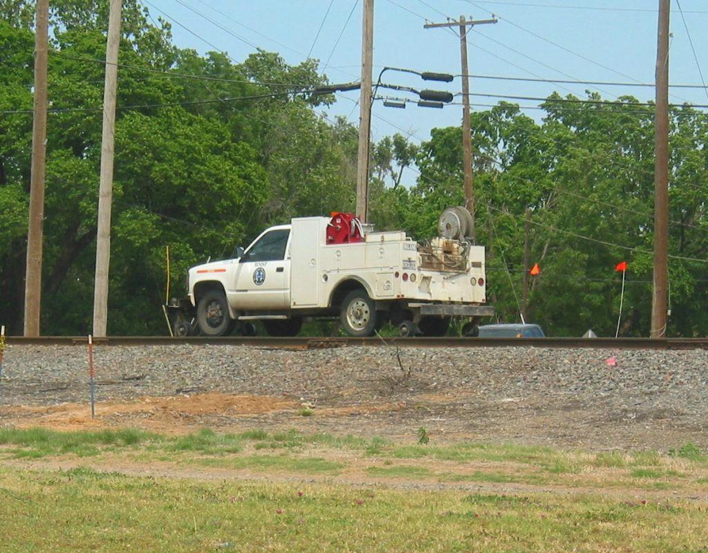 bnsf hy-rail truck going down the rails
