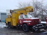 ford hy-rail bucket truck parked