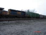 CSX 8834 is last in the loco consist w/MRRX Woodchip Hopper 4117 EB