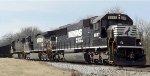 NS SD60 6697 leads empty hopper train into John Sevier yard.
