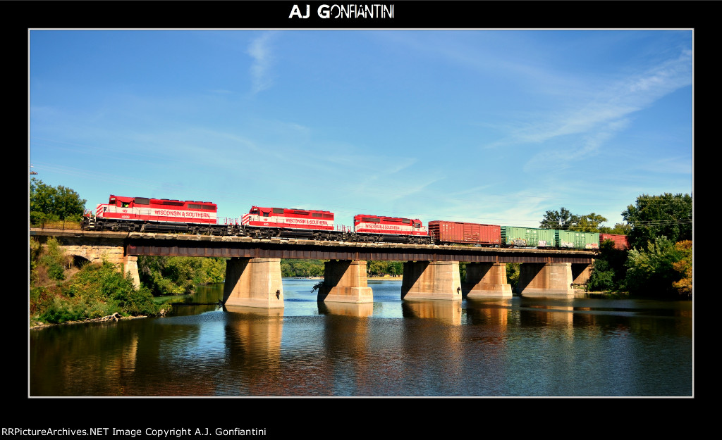 Finally got this shot. WSOR 4009, 4001, and 4007 bring T004-14 through Janesville on a beautiful September morning