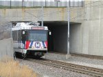 St. Louis MetroLink train emerges from North Hanley underpass approaching the Station