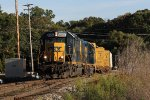 CSX 6954 rolls over the switch at Seymour as D707 returns west from Lansing