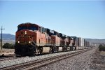 Westbound stack train climbs upgrade