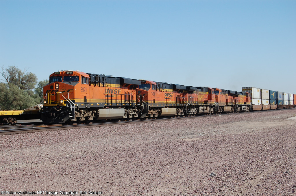 Westbound BNSF intermodal passes a UP westbound manifest