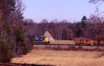 CSX 6242 South, passing by the Meade Pyramid and a stopped work train