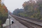 NS stone train approaching Cooke Road in N. Columbus