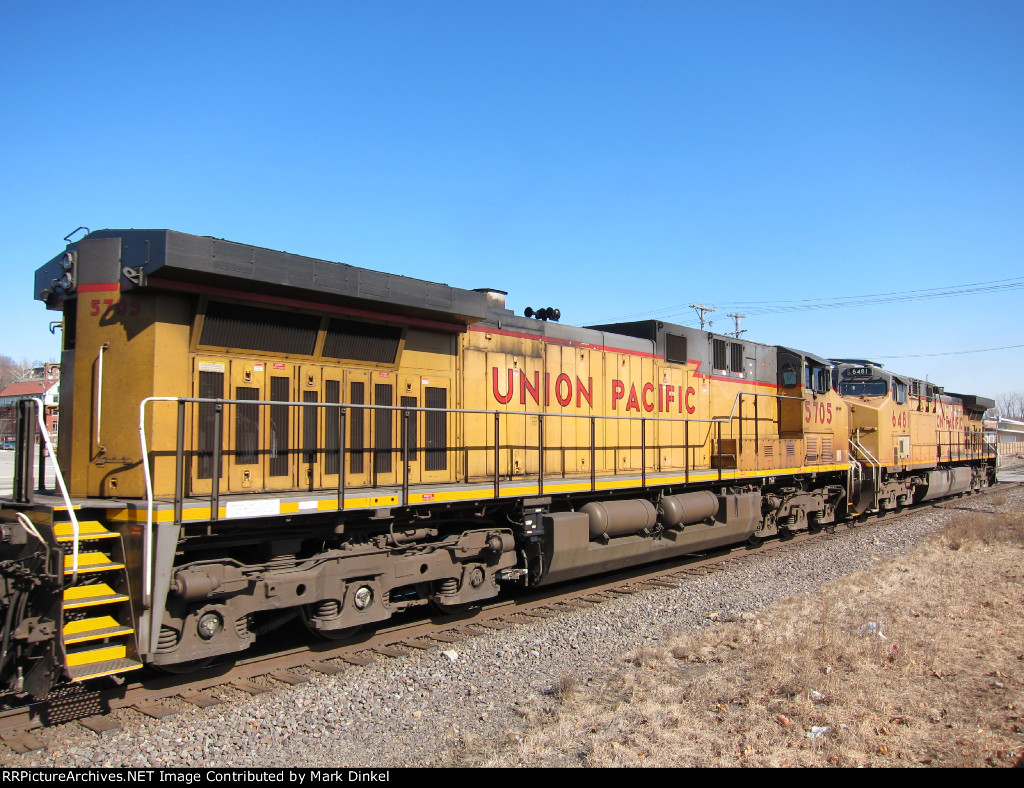 Union Pacific AC44CWCTE no. 5705 and AC44CW no. 6481 on the tail end of a westbound empty coal train moving up from the western banks of the Missouri River