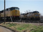 Union Pacific SD60M no. 2458 stands watch at the Salina, Kansas, yard while Union Pacific AC44CCTE no. 7352 and AC44CW no. 6840 face west