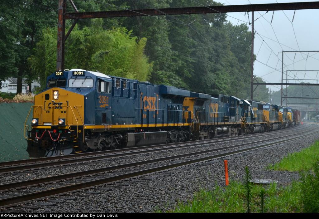 CSX ES44AH 3091 leads Q438-23