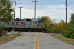 KCS 2826 Leads a yard job across a crossing.