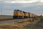 UP 4909 Leads a auto train at Sunset.