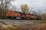 BNSF 6099 Leans on a empty coal train.