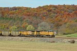 UP 7097 Heads up a coal drag along the fall colored bluffs.