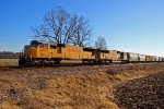 2 UP SD70m's lead a freight NB.