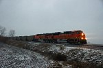 BNSF 9167 Leads a loaded coal drag in the freezing rain.