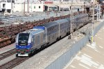 Amtrak train #768 is led by Caltrans Charger CDTX #2111 towards San Diego.