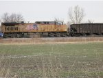 On a cold November morning, Union Pacific AC44CWCTE no. 5950 waits while Union Pacific AC44CW no. 6434 takes on fuel east of town with an eastbound coal train