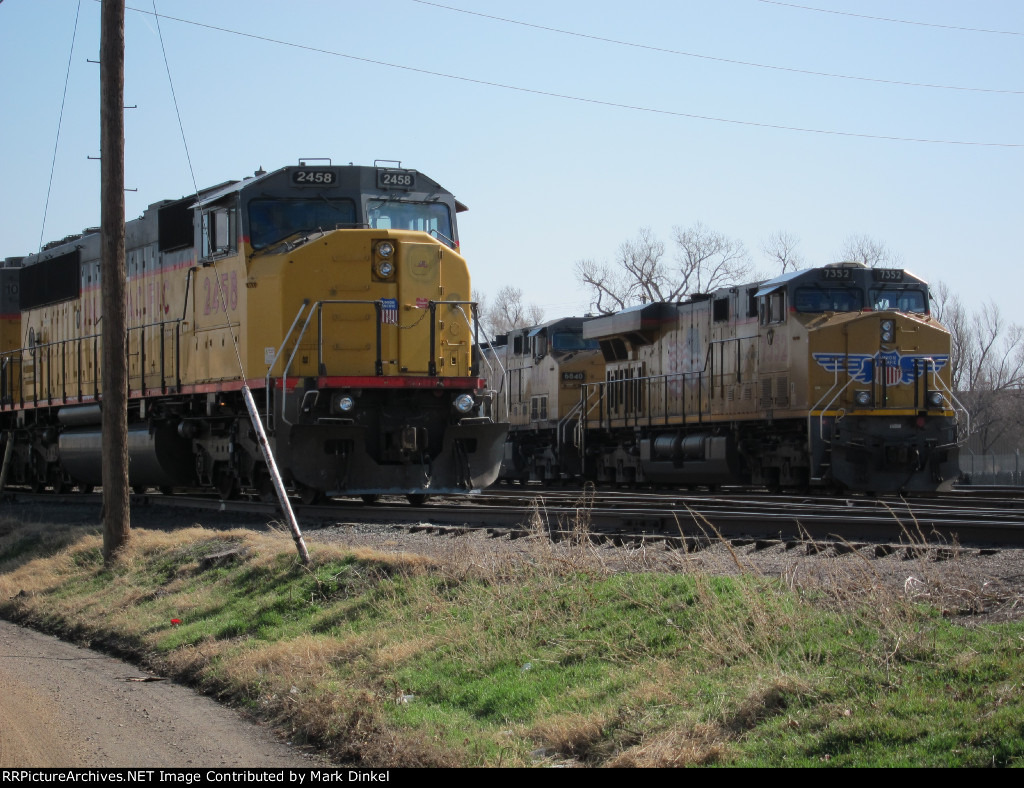 Union Pacific SD 60M stands watch at the Union Pacific Salina, Kansas yard while Union Pacific 7352 and 6840 face west