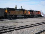 BNSF ES44AC 5980 and SD70MAC 8917 move a train past the station area