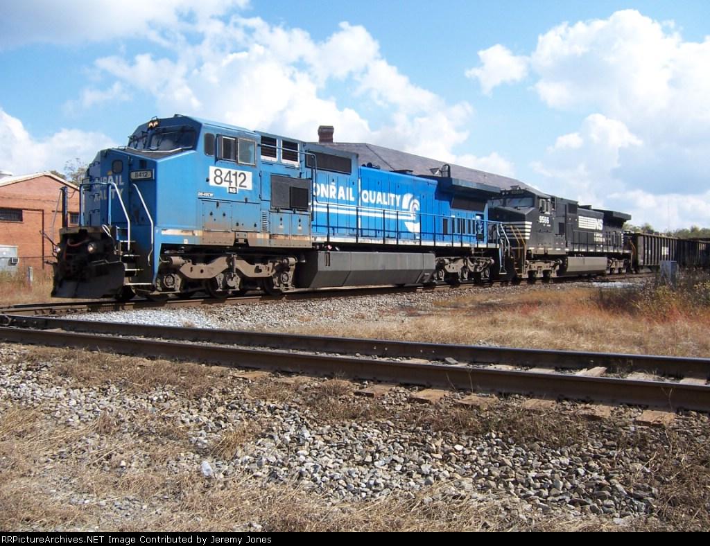 Ex-Conrail Big Blue leads an NS train over the CSX Interlock