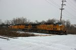 UP 6797 leads a trio of power on a loaded grain train.
