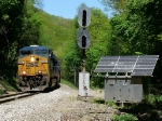 CSX 831 rolls by the still standing Clinchfield signal deep in the heart of the Breaks Gorge...