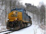 CSX 897 dashes through the snow under Pinnacle Rock on the Coal Fork Sub.