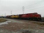 A Pair Of Canadian GE's Sandwich a UP SD70M